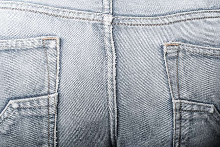 detail of jeans trousers in the foreground 写真素材