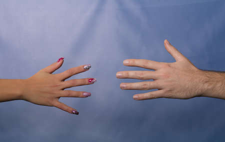 male and female hands approaching