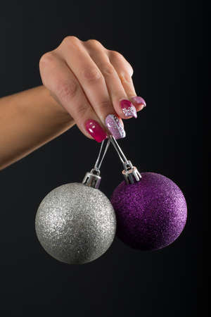 Pink and purple nail and Christmas ball 写真素材