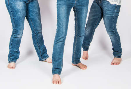 girls legs with blue jeans