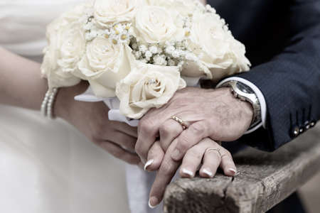 hands of newlyweds on their wedding day 写真素材