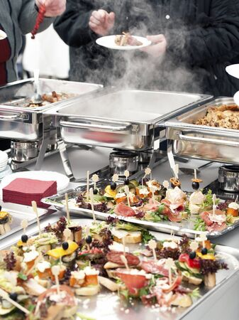 holiday catering: People choosing food from buffet