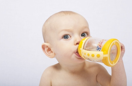 baby with her baby bottle
