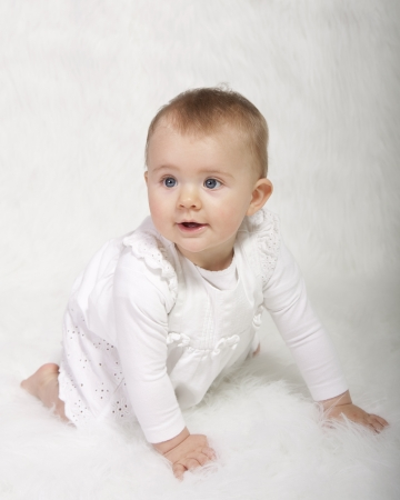 baby girl in christening gown photo