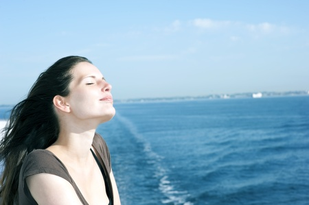 Portrait of a relaxing woman on the upper deck of a cruise ship  Stock Photo