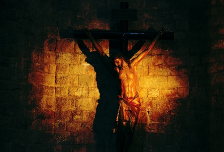 tortured body: Sculpture of crucified Jesus  Stock Photo