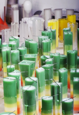 holiday maker: Decorative candlemaking using colorful wax at a professional chandler Editorial