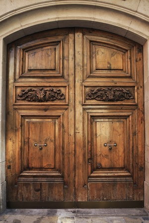 Old wooden door with ornaments Stock Photo