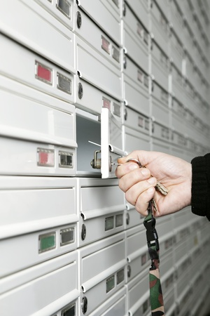 Male hand opening letter box photo