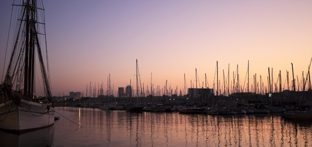 Panorama with sunset over Port Vell , Barcelona photo