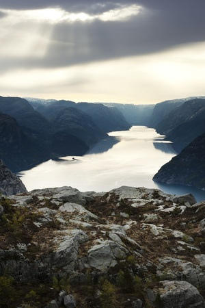 Looking down the length of a deep fjord in misty overcast weather photo
