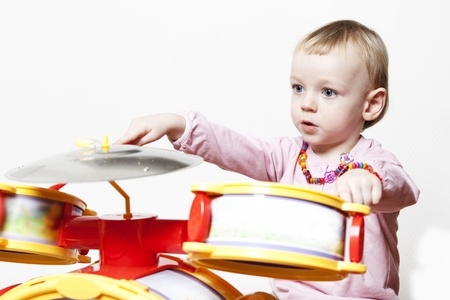 Creative young excited child playing percussion kit photo