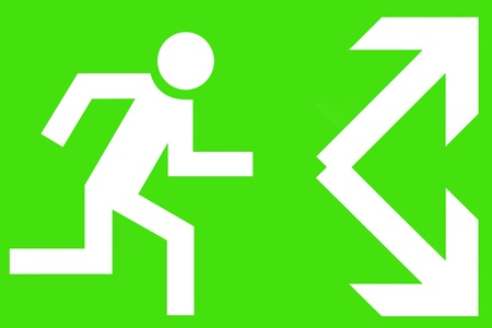 Emergency exit sign showing a running man and arrows on a green background photo