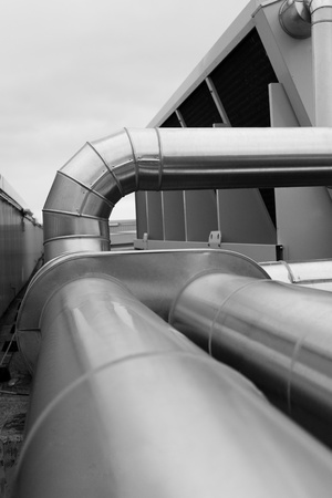 Selective focus showing a bend and elbow in a large ventilation duct used for ventilation, heat and air conditioning Stock Photo - 12000881