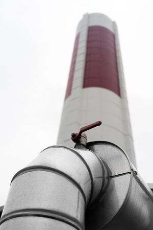 tall chimney: Closeup of a elbow in a large industrial ventilation duct that leads to a tall chimney Stock Photo