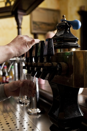 pouring beer: Man dispensing drought beer from generator