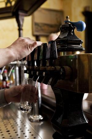 tap room: Man dispensing drought beer from generator