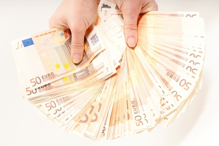 liquidate: Hands holding 5000 euro in banknotes