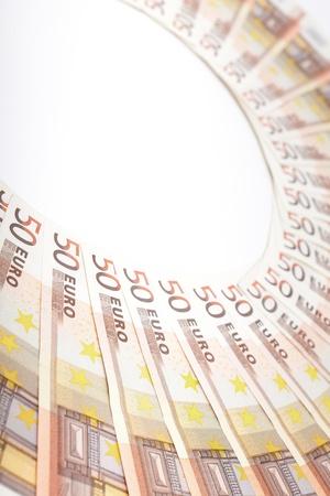 Euro banknotes arranged in a semi-circle