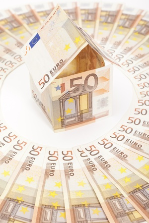Euro house and banknotes Stock Photo