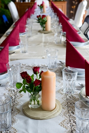 restaurant setting: Banquet table setting themed with roses Stock Photo