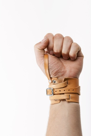 strengthen hand: Male wrist bound with leather bandage Stock Photo