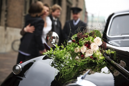 chauffeur: Beautiful bridal bouquet on car bonnet