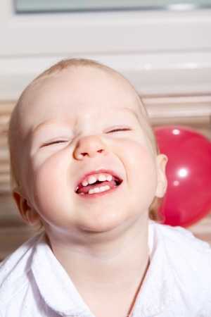 Smiling young baby girl showing primary baby teeth Stock Photo - 14724885