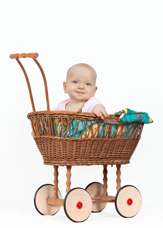 Young baby girl in a wicker pram Stock Photo - 15769584