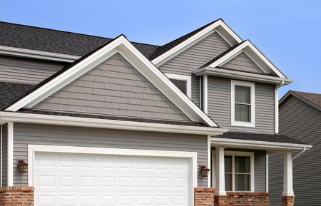 New construction of a contemporary two story home with gray siding