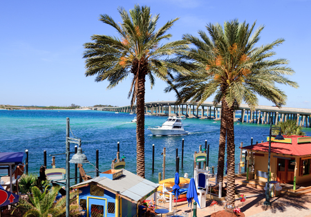 Gulf Shore ocean inlet with boats, restaurants, shopping for tourist.