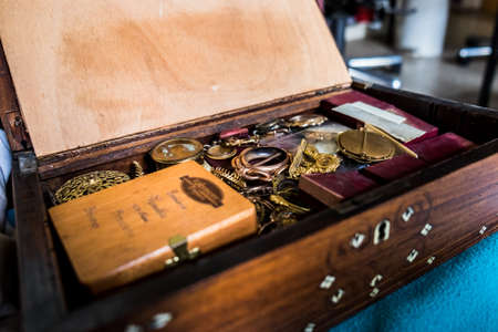 Crate with a vintage medallion and a lot of jewellery