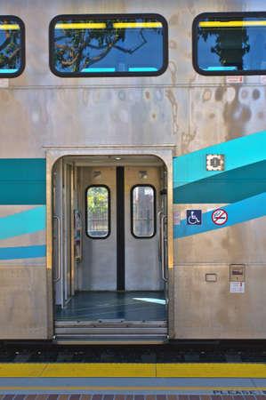 Open doors on an empty commuter train car. Stock fotó