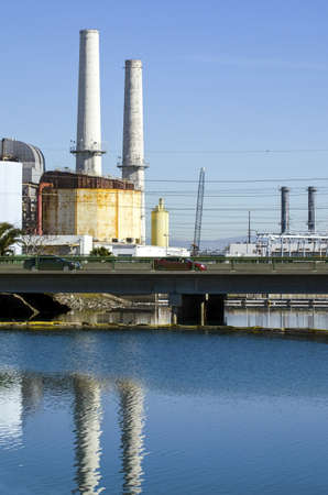 eyesore: A pair of smokestacks and other buildings associated with a power generating facility. Stock Photo