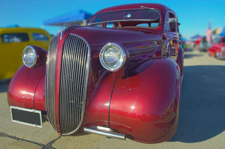 A restored vintage roadster from the 1930s.