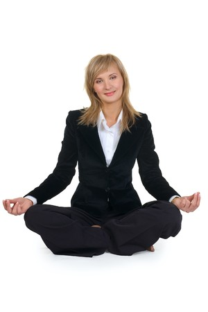 Woman sitting in lotus position. Isolated over white. photo