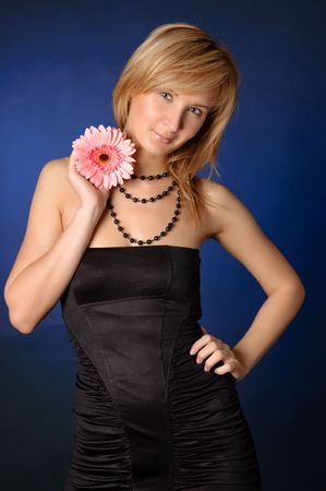 beautiful girl with a flower. Black background . photo