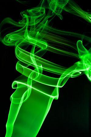 green smoke: abstract green smoke . black background