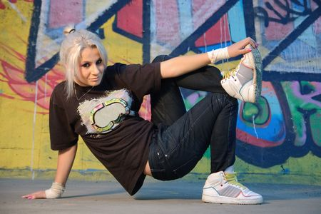 Young woman breakdancing photo