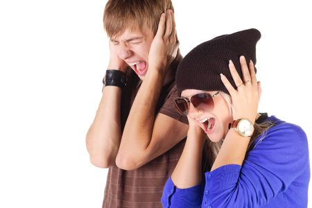 Young couple screaming. Isolated over white. Stock Photo - 5510769