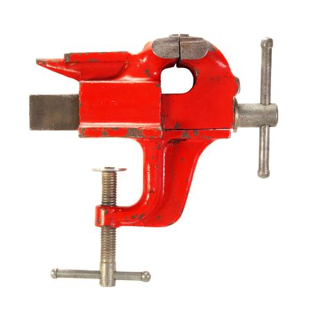 vise: Old red vise . Isolated over white .