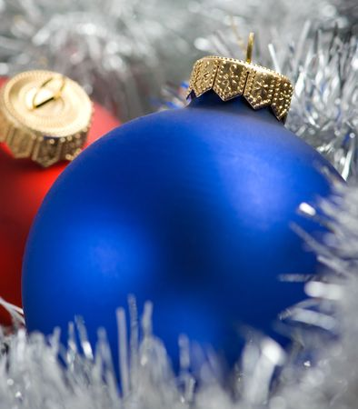 Colorful christmas balls in silver garland background  photo