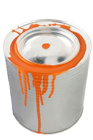 Tin of a orange paint. Isolated over white   photo
