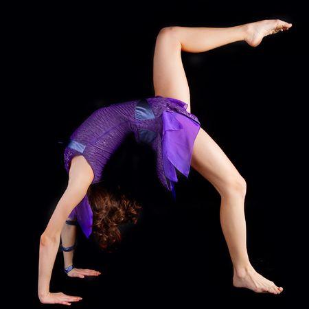young yoga female doing yogatic exericise . Black background Stock Photo - 5865628