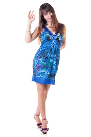 beautiful brunette in a dress showing ok gesture. Isolated over white background . Stock Photo - 6015999