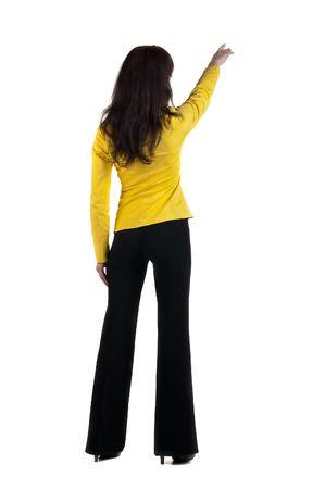 Young woman points at wall.  Zdjęcie Seryjne
