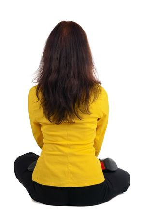 beautiful businesswoman exercising yoga. Rear view .  photo