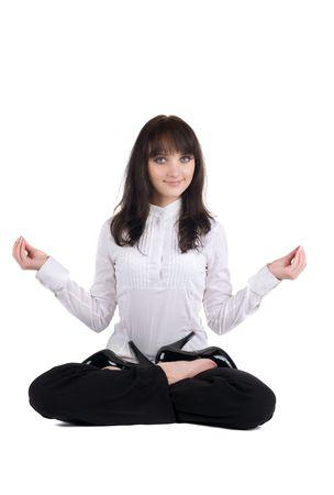 yoga pants: beautiful businesswoman exercising yoga . Isolated over white background .
