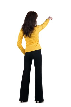 specifies: Young woman points at wall. The rear view .