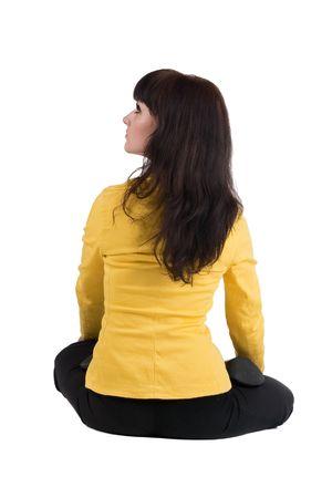 people sitting: beautiful businesswoman exercising yoga. Rear view .